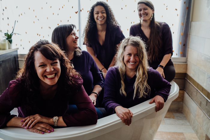 Seasons Midwives laughing in tub